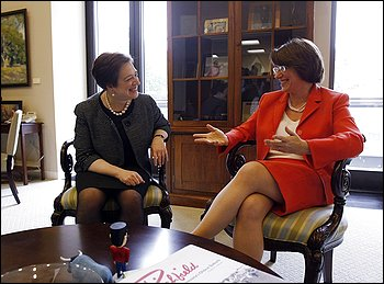 UNUSUAL: Most women, including Sen. Amy Klobuchar, cross their legs when sitting, but not Kagan. (Hyungwon Kang - Reuters)