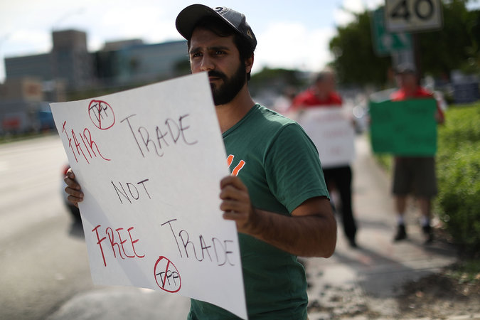 Pro-fair trade demonstrator (photo: Joe Raedle/Getty)