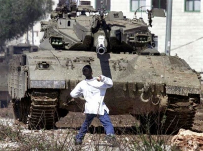AP image of Faris Odeh, later killed by Israeli forces, confronting an Israeli tank