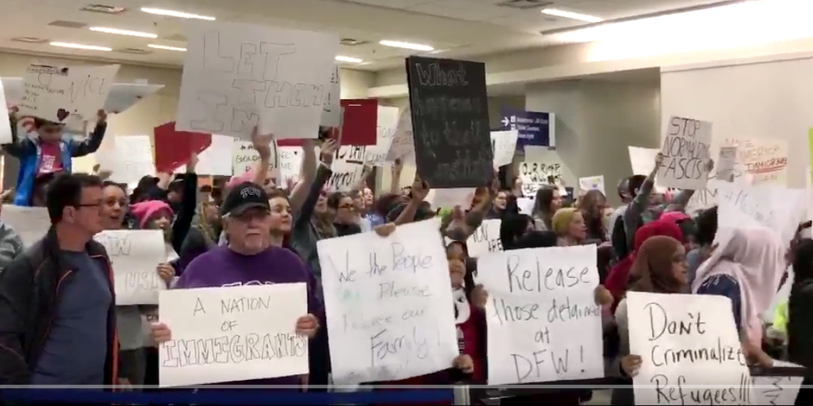 Protest against Trump's immigration ban at Dallas/Ft. Worth airport (image: @caldwell_court)