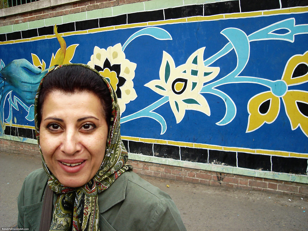 Woman with street art in Iran
