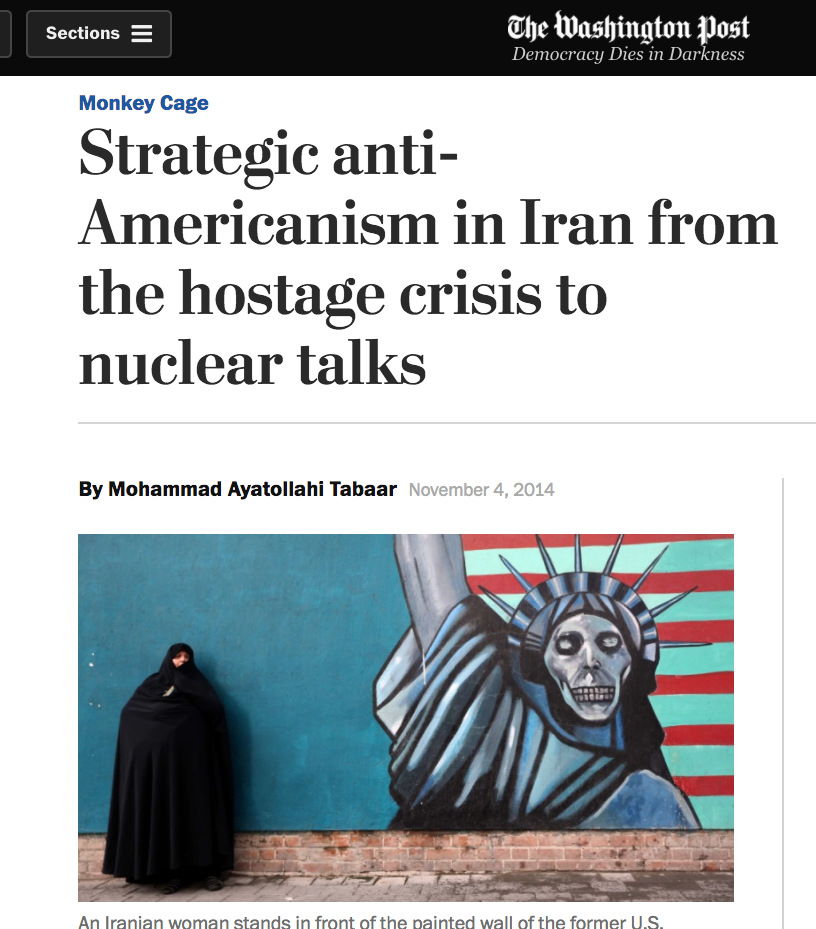 Washington Post photo of woman in chador by anti-American mural