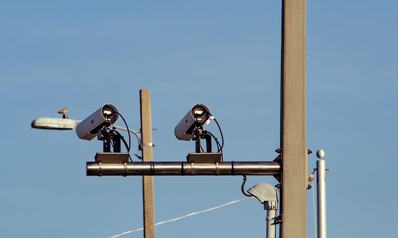 Automated license plate reader (ALPR/LPR) cameras scan license plates of cars crossing into Pensacola Beach, Florida