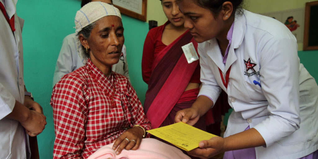 Unnamed mother brings her child to be vaccinated for BCG during routine vaccinations at District Public Health Office, Immunization Clinic , Pokhara , Nepal