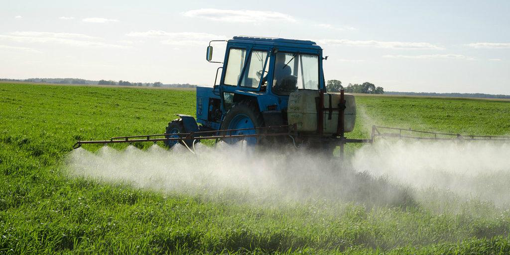 Tractor spraying herbicide (cc photo: Aqua Mechanical)