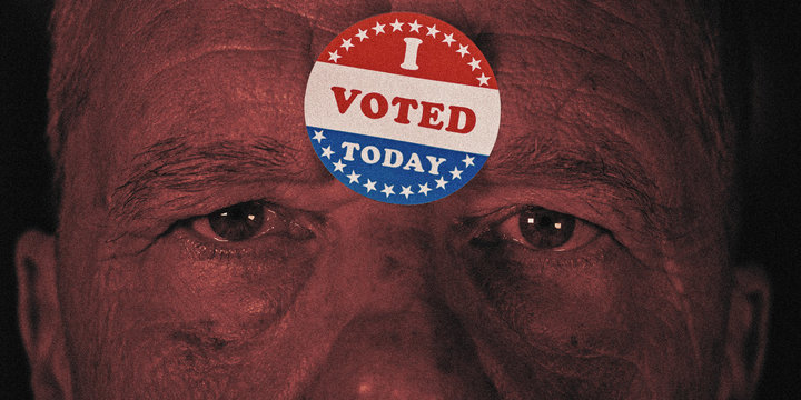 I Voted Today sticker on senior caucasian mans forehead with angry stern stare at camera
