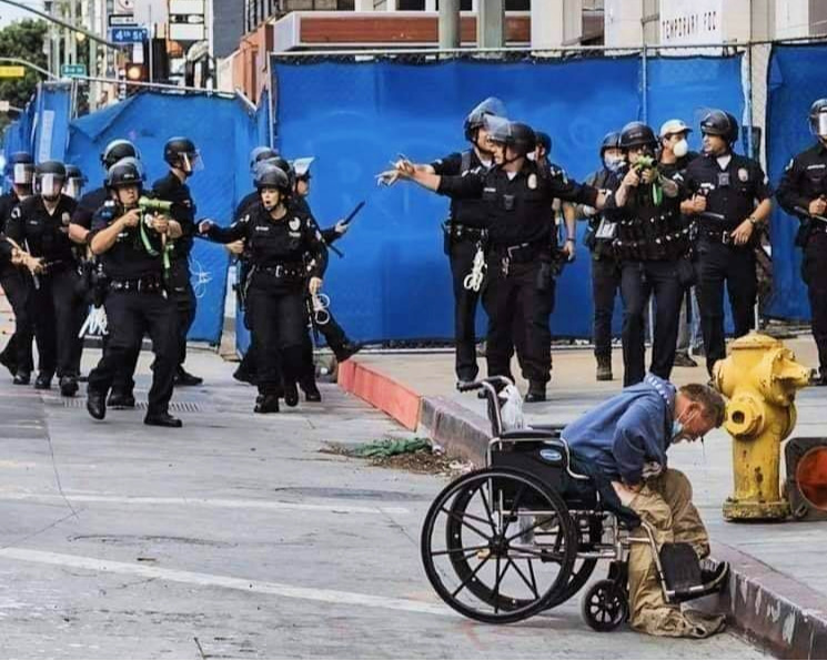 Homeless man Charf Lloyd being attacked by LAPD, in a photo taken and posted to Facebook by Kirk Tsonos