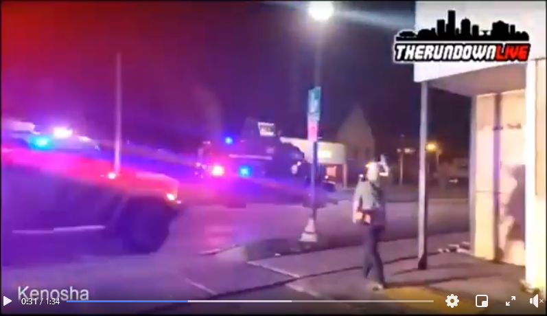 Kenosha police in military vehicles greet Kyle Rittenhouse