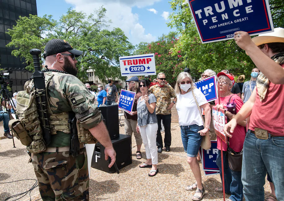 "Washington Post: ""Armed men push a crowd back after a fight broke out in downtown square in Tyler, Tex., whoen two opposing groups clashed on July 26. (Sarah A. Miller/AP)"""