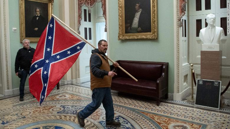 CNN depiction of rioter carrying Confederate flag in the Capitol