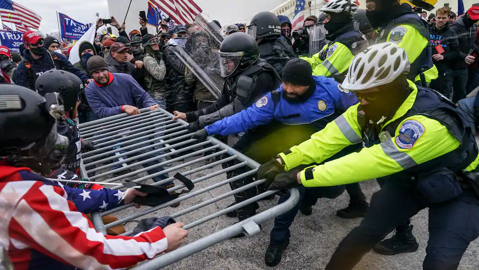 Washington Post image of far-right militants assaulting the Capitol