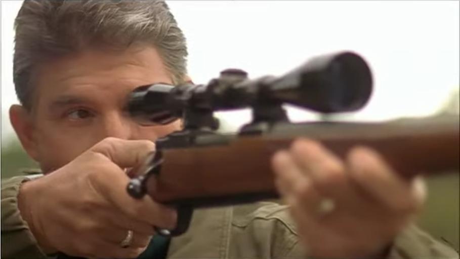 Joe Manchin with rifle